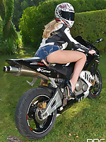 Busty Blonde Strips and Goes Doggy Style Atop Motorcycle free photos and videos on 1By-Day.com