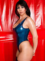 Desyra Noir posing in blue latex swimsuit | DesyraNoir.com