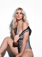 Jess Davies British Glamour Model teasing in her bodysuit